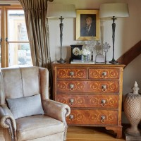 Country living room with antique dresser and twin lamps