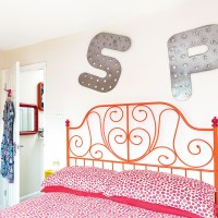 Modern bedroom with strawberry bed linen and patterned chest of drawers