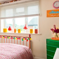 Pretty bedroom with patterned bedding and bright colours