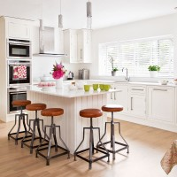 Modern kitchen with island and vintage stools