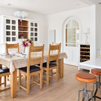 White modern kitchen-diner with farmhouse-style dining table