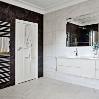 Hotel-chic bathroom with marble-effect monochrome tiles