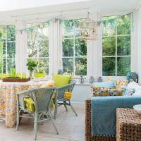 Modern conservatory with colourful rattan furniure