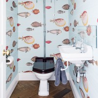 Traditional cloakroom with fish motif wallpaper