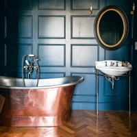 Blue traditional bathroom with copper roll-top bath