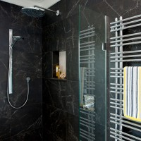 Black shower area with marble-effect tiles