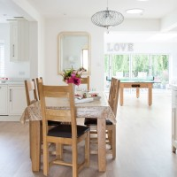 Bright white open-plan kitchen with pretty dining area