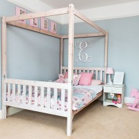 Girl's blue and pink bedroom with statement canopy bed