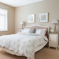 Pretty bedroom in graduating neutral tones and floral bedding