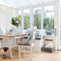 White conservatory with duck-egg blue cushions