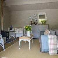 Country summerhouse with panelling and woodburner