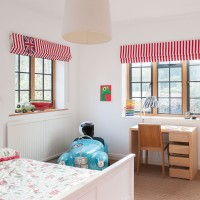 Child's bedroom with red and white striped blinds