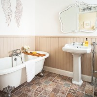 Neutral bathroom with wood panelling and statement floor tiles