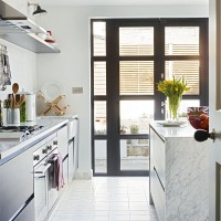 Modern white kitchen with grey French doors