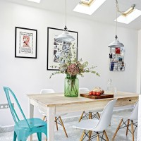 Modern white dining room with mix and match chairs