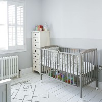 Modern white nursery with grey painted cot