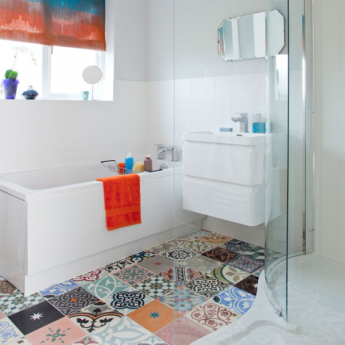 Modern white bathroom with colourful patterned tiles