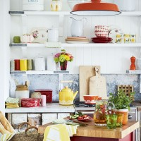 White kitchen shelves with bright accessories