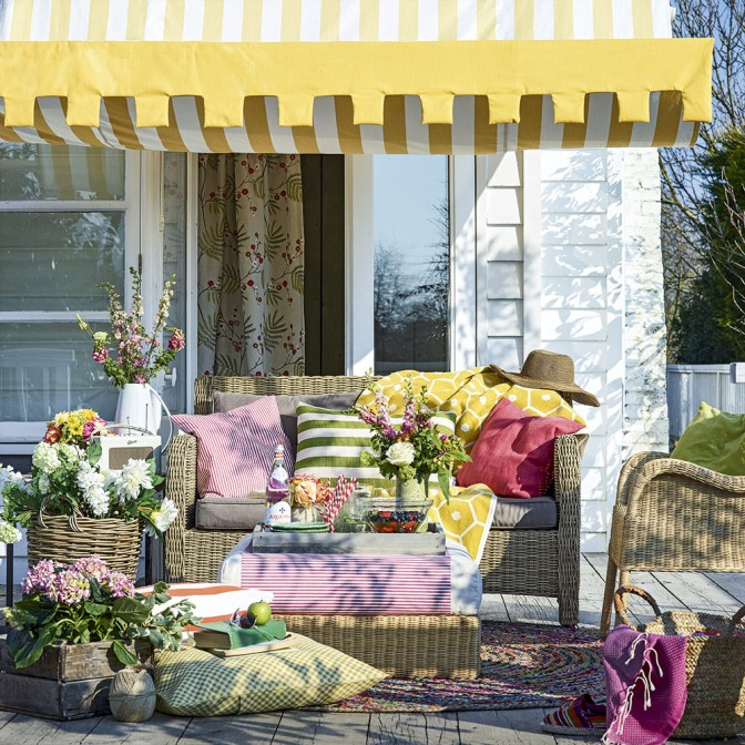 Colourful garden decking with yellow striped awning