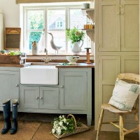 Country-style kitchen with butler sink and freestanding storage
