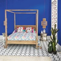 Bright blue bedroom with carnival prints and smart tiles