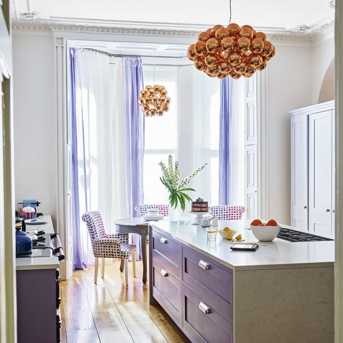 Lilac kitchen with copper accents