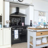 Country kitchen with a bespoke splashback