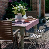 Country garden patio with shabby chic dining area