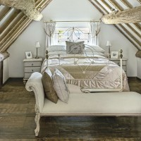 Country bedroom with antique chaise longue