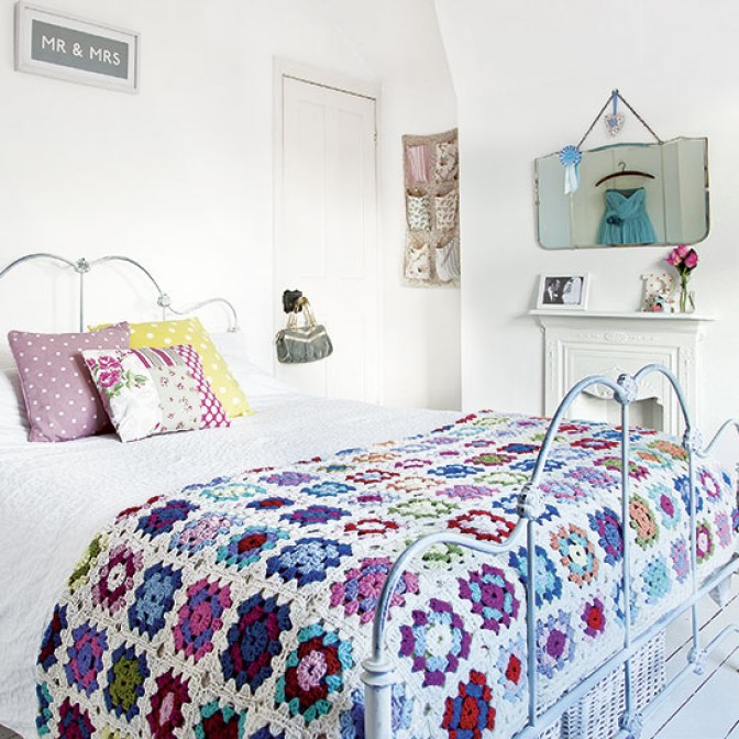 Traditional bedroom with crochet granny blanket