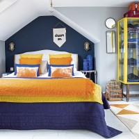 Modern bedroom with vibrant blue and orange scheme