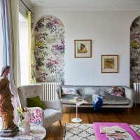 Modern living room with floral feature wallpaper