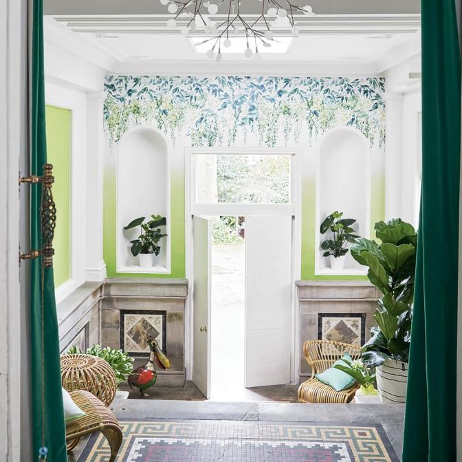 Fresh green hallway with summery wallpaper