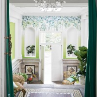 Fresh green hallway with summery wallpaper