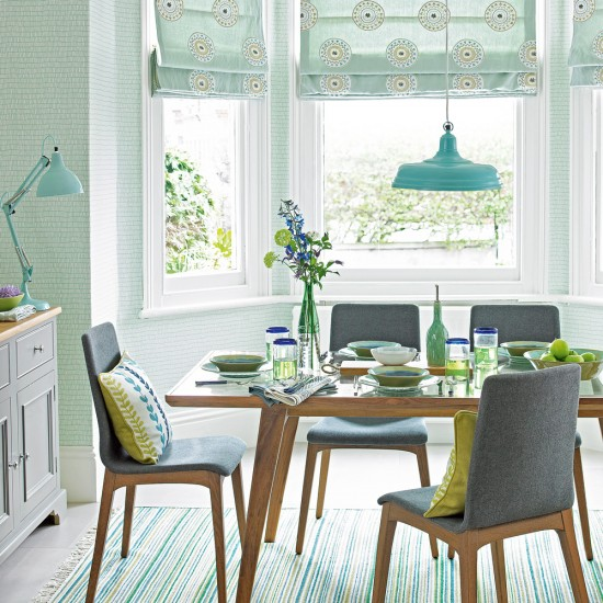 Mint green dining room with mid century style furniture for Light green dining room