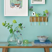 Spearmint hallway with wooden console table and picture frames