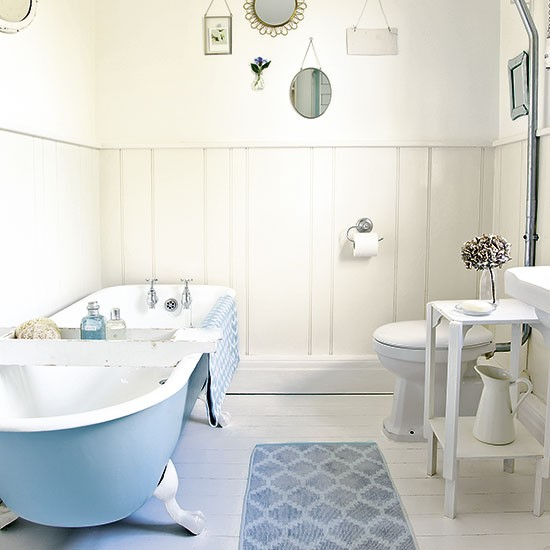 Country bathroom with powder blue bath for Powder blue bathroom ideas