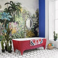 Jungle-inspired bathroom with red gloss bath
