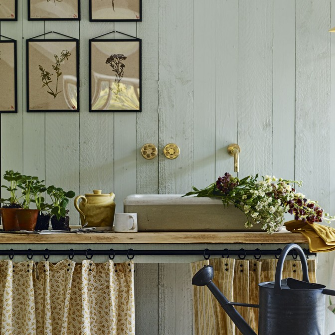 Rustic utility room with tongue-and-groove panelling and mint green walls