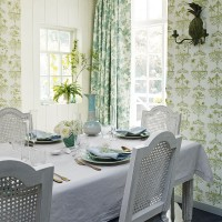 Country-style dining room with botanical-inspired wallpaper and summer palette