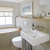 Neutral modern bathroom with wood surfaces