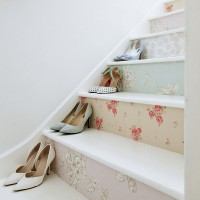 White hallway with floral wallpaper stair risers