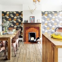 Smart dining room with stripped floor and feature wallpaper