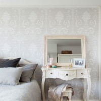 Pretty bedroom with pale grey damask-style wallpaper