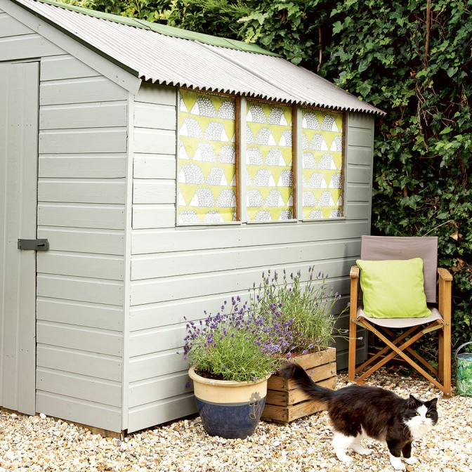 Garden shed with perked up paint and fabric blinds