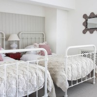 Country children's bedroom with chunky knitted throws