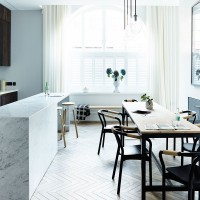 A sophisticated white dining space with natural textures