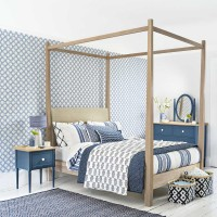 Blue and white bedroom with a mixture of patterns