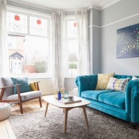 Be inspired by a living room anchored by a bold blue sofa