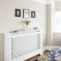 Hallway with decorative mantlepiece radiator protector